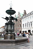Tourist around Stork Fountain and Amager Square in Copenhagen, Denmark