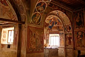 Arches and paintings with small windows of San Carlo church in Lugano, Switzerland