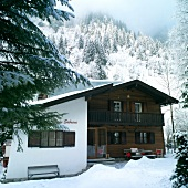 Wooden rustic house rooftop covered with snow, Austria