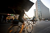 People riding bicycle at Friedrichstrasse station, Berlin, Germany, blurred motion