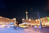 Tram in passing at Alexanderplatz, Mitte, Berlin, Germany, blurred motion