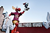 Low angle view of Boulevard Hollywood hotel and Dogs Hounds figure, Los Angeles, USA