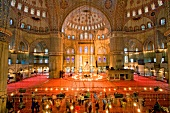 View of illuminated Sultan Ahmed Mosque domes pillars, Istanbul, Turkey, blurred motion