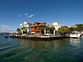 View of wooden houses with blue sky on Bosphorus shore in Istanbul, Turkey