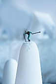 A skier figurine on sugar loaf