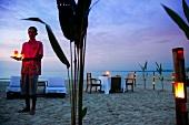 Man holding lantern at Phuket Luxury Hotel, Thailand