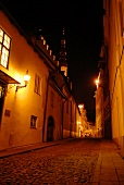 View of empty streets with street lights at night in Tallinn, Estonia, Russia