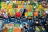 Overhead view of people and different fruits and vegetables in Funchal, Madeira, Portugal
