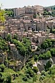 View of Sorano town on rocky plateau in Maremma, Tuscany, Italy