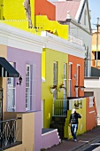 Man walking near colourful houses at Bo-kaap, Cape Town, South Africa