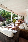 View of Villa Coloniale porch with wicker furniture, Cape Town, South Africa