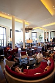 People sitting in lounge of One & Only Cape Town Luxury Hotel, South Africa