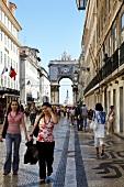 People walking on mosaic paving, Rua Augusta, Lisbon, Portugal