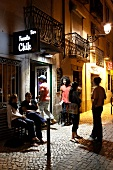 People in front of Bar Favela at night, Bairro Alto, Lisbon, Portugal
