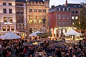 Crowd at Karlsplatz fountain in centre of market place at Aachen, Germany
