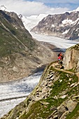 Hikers walking in Aletsch Glacier at Valais, Switzerland
