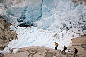 Hikers in front of ice wall in Aletsch Glacier, Marjelesee, Valais, Switzerland