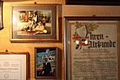 Close-up of pictures of landlady Hannelore Behrens on wall in Rudesheim, Germany