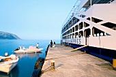 Tourists standing on pier of Agia Roumeli port in Crete, Greece