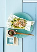 Steamed salmon with spicy dressing on plate