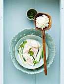 Salmon in coconut sauce with rice (Asia)