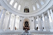 Interior of Cathedral of St. Blaise with white columns and dome in Black Forest, Germany