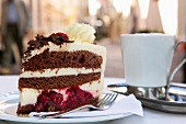 Piece of black forest cake on plate