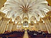 People sitting in Sagrada Familia Church, Barcelona, Spain