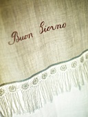 Close-up of embroidered linen in Hotel Cavoleto, Tuscany, Italy