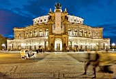 Facade of Dresden Semper Opera House at night, Saxony, Germany, blurred motion