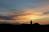 View of Kampen lighthouse at dusk in Sylt, Germany