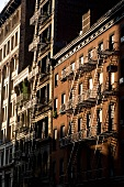 View of building with fire escape at evening, SoHo, New York, USA
