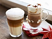 A latte macchiato and a chocolate coffee decorated with cocoa stars