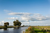 View of flowing water, landscape, clouds and sky at Worpswede, Germany