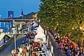 People enjoying festival in harbour side at dusk, Bremen, Germany