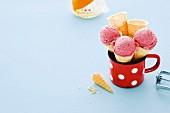 Homemade strawberry ice cream in cones