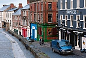 Colourful house with cars on street of Derry, Ireland
