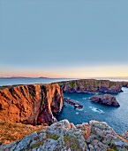 View of rocky coast of Atlantic at sunset in Tory Island, Ireland
