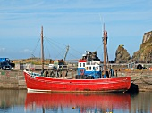 Red fishing boat in Cape Clear Island, Ireland