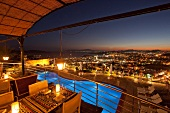 View of restaurant Tuti in Mamara hotel with cityscape at night in Istanbul, Turkey