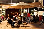 People sitting in open area at Waranga Club Lounge, Stuttgart, Germany