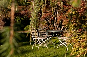 Table and chairs in Mount Usher Garden, Ashford, Ireland, UK