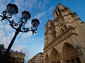 Low angle view of facade of Notre Dame cathedral in Paris, France