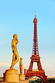 Eiffel Tower and golden statues in Paris, France