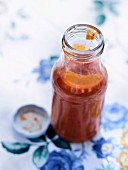 A bottle of homemade tomato and plum ketchup