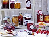 Preserved fruit and jars of jam on a shelf