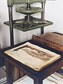 Book with copper engraving on wooden table