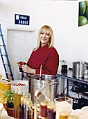 Portrait of marmalade cook Stefanie Kleinjung cutting strawberries