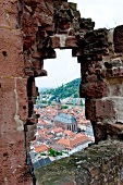View of Old Town through window at Heidelberg Castle, Germany