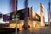 Facade of illuminated German Emigration centre in Bremerhaven, Bremen, Germany